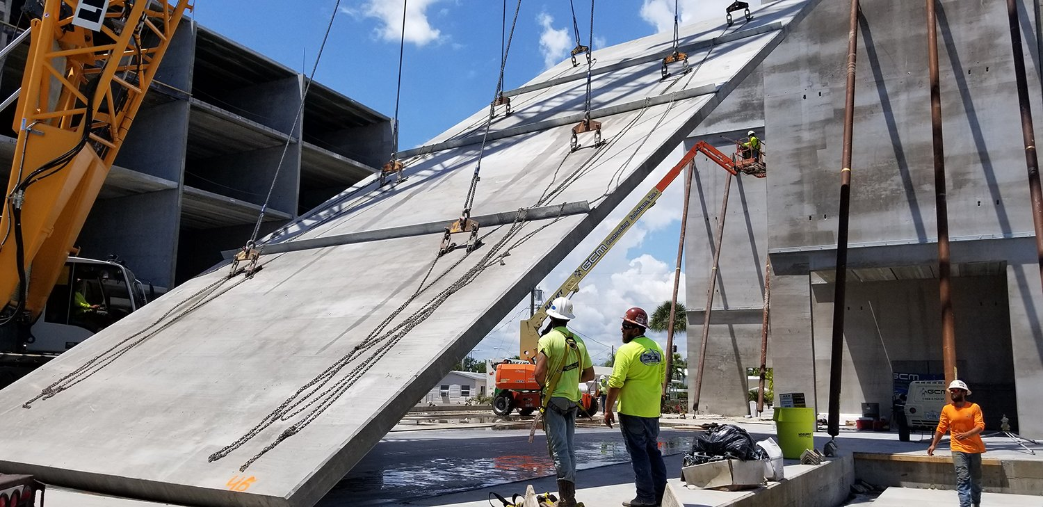 A concrete tilt-wall panel being lifted at Gulf Star Marina.